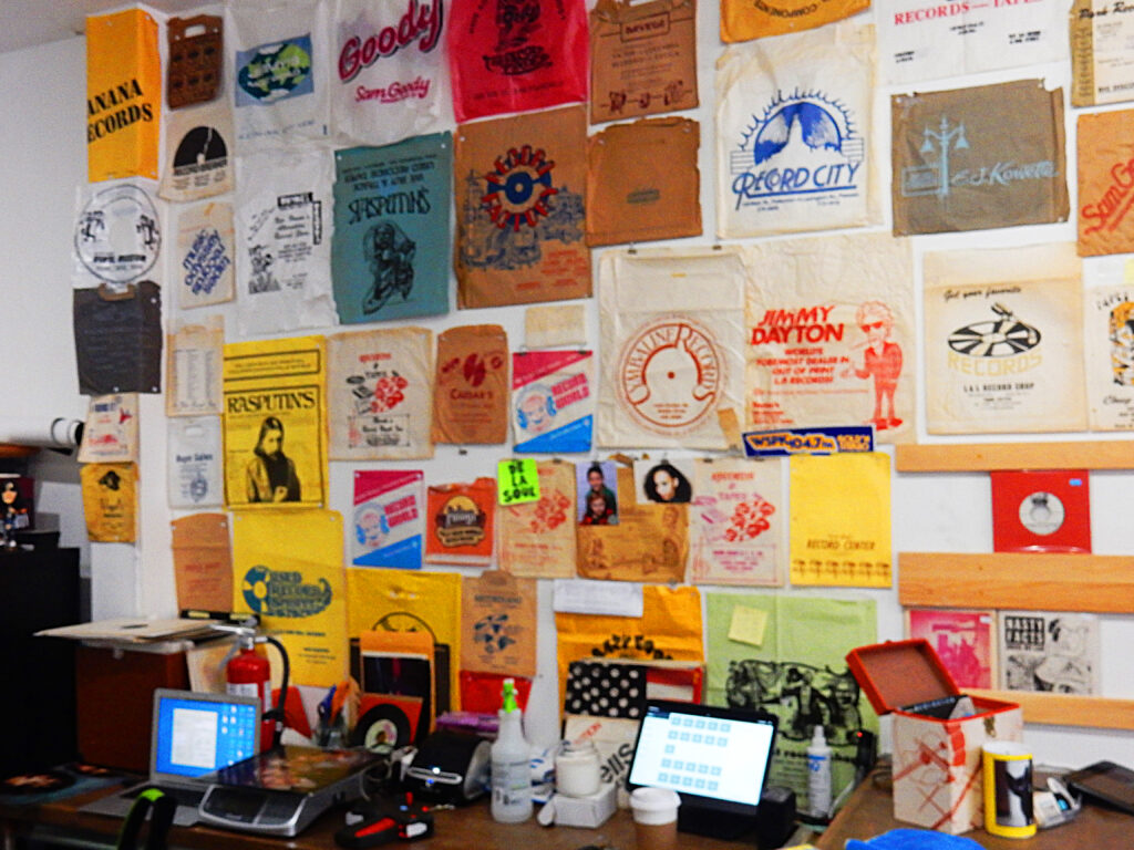 A wall of record store bags from long gone stores